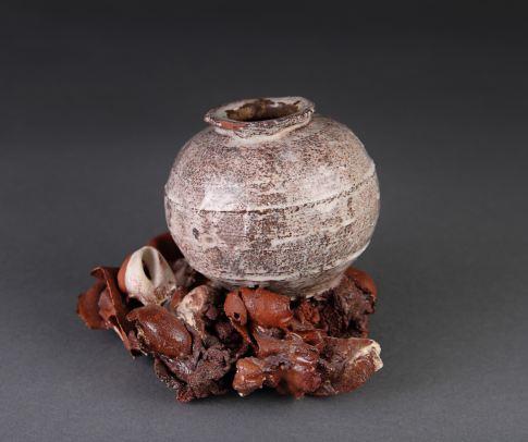 "one Tang poem. jar in situ. approx 6"" tall. terra cotta."