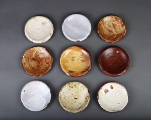 "9 side plates. each approx 4"" diam. terra cotta."