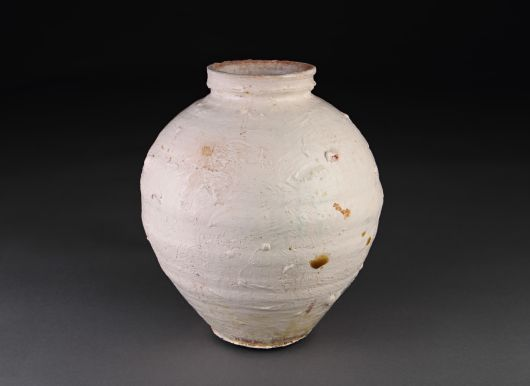 """water jar. approx 11"""" tall. terra cotta."""