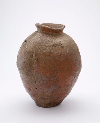 Narrow-necked storage jar Medium: Stoneware with natural wood-ash glaze Dimensions: H x Diam (overall): 47 x 36.8 cm (18 1/2 x 14 1/2 in) Style: Shigaraki ware Type: Ceramic, Vessel Origin: Probably Minami Matsuo kilns, Shigaraki, Shiga prefecture, Japan Topic: Shigaraki ware, Muromachi period (1333 - 1573), Japan, stoneware, Japanese Art Credit Line: Purchase Date: 1400-1450 Period: Muromachi period