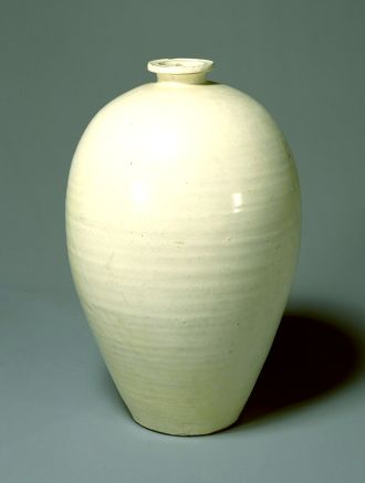 Vase with colorless glaze over white slip.