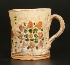 Very Rare Redware Mug with Sgraffito Floral Decoration, Southeastern PA origin, circa 1825. Provenance: A fresh-to-the-market example from an eighty-y