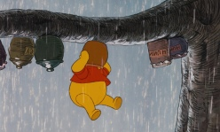 Winnie_the_Pooh_has_his_head_stuck_in_his_honey_pot